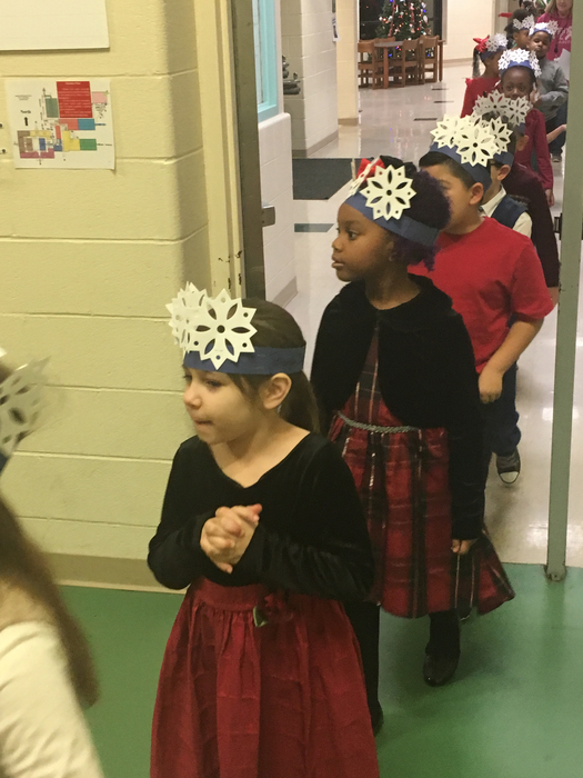 1st and 2nd graders headed in for Holiday Concert!