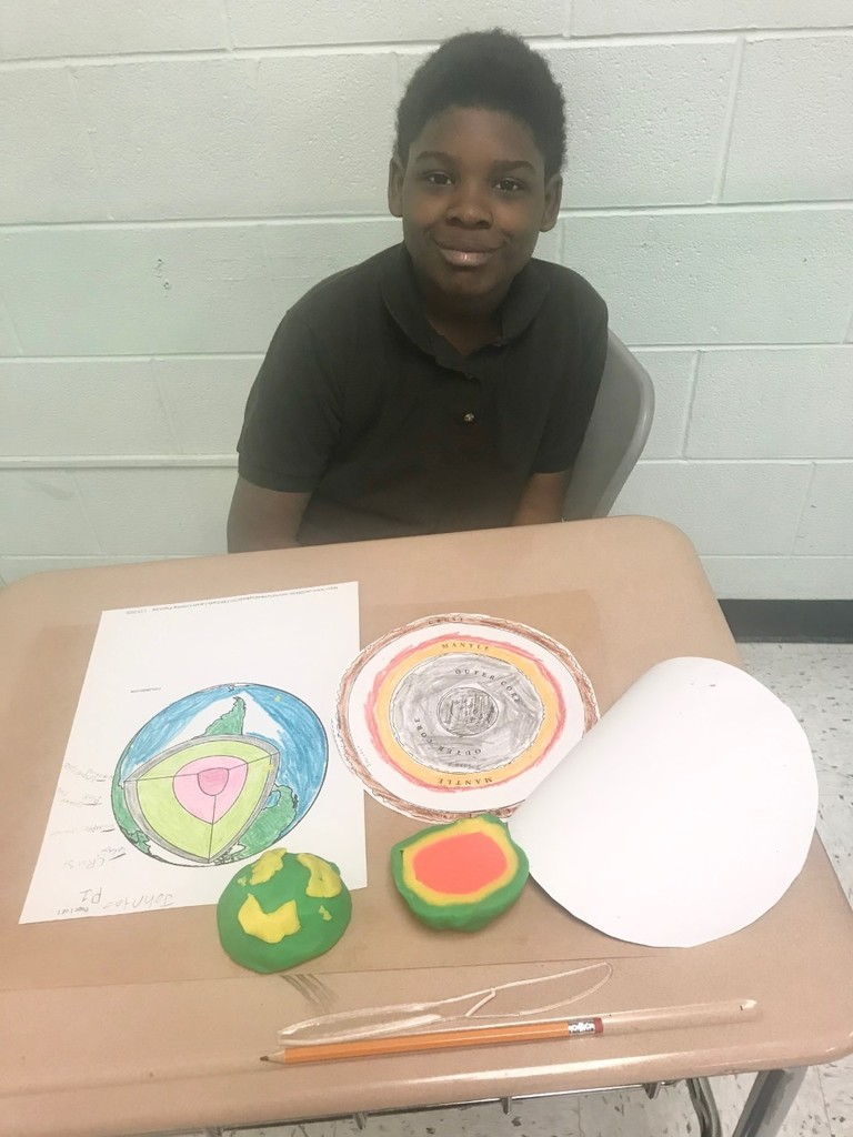 Students Creating Clay Models of the Earth and its Layers.